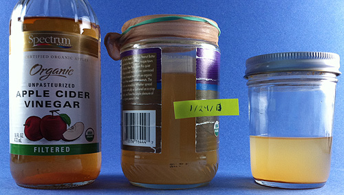 three stages of making homemade apple cider vinegar in jars