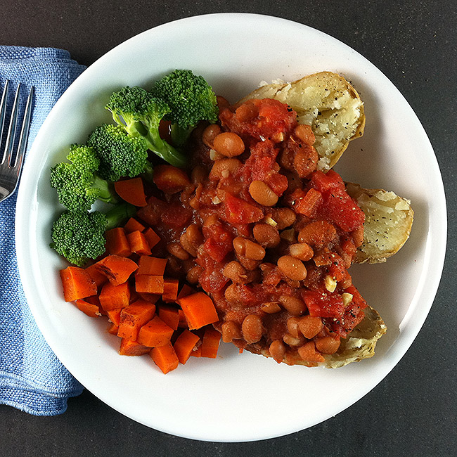Pinto beans on baked potatoes with carrots and broccoli