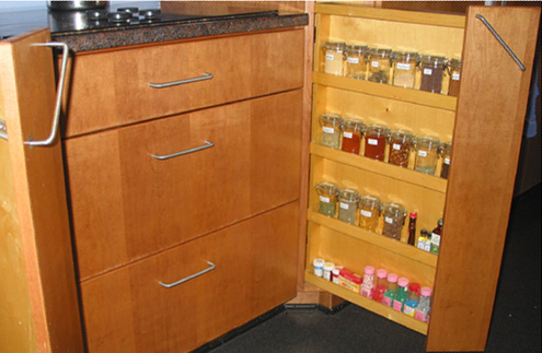 organized spice rack with spices in alphabetical order in labeled jars