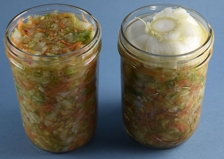 fermenting in jars with vegetable topper to keep vegetables submerged