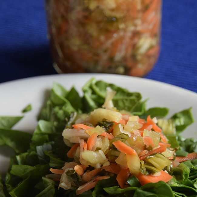 Fermented bok choy and cabbage on spinach salad