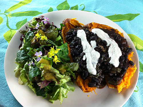 lunch - spring salad with a baked sweet potato and black beans