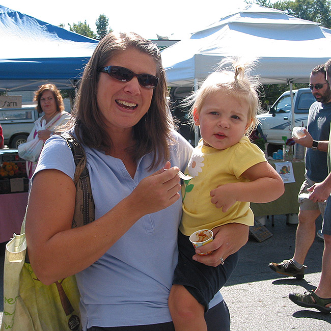 Mother and child at farmers market love my curry