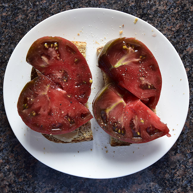 tomato tahini toast with red tomato