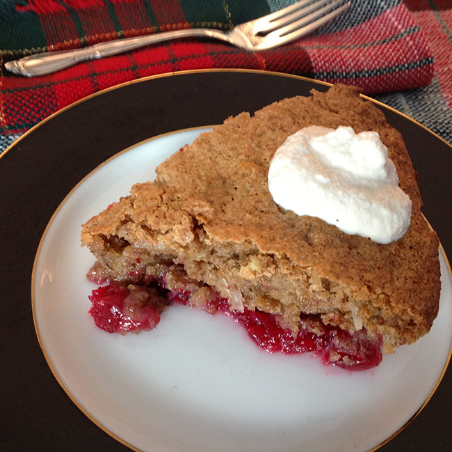 slice of Cranberry Pie with Cashew Cream on a winter holiday tablecloth