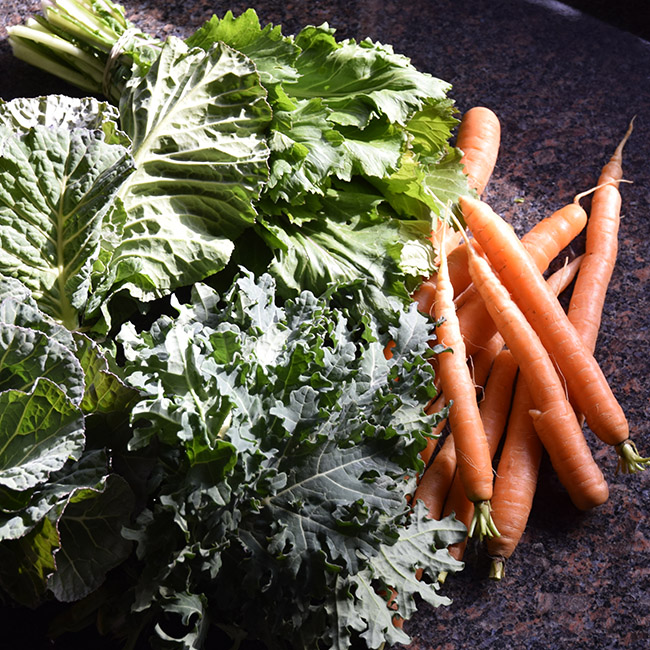 farmers' market vegetables February: carrots, collards, kale, mizuna