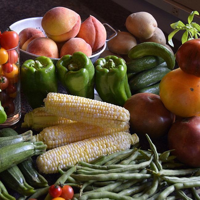 seasonal produce July: peaches, peppers, corn, green beans, zucchini, tomatoes, potatoes, basil