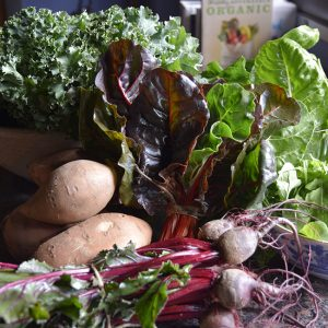 March seasonal vegetables: sweet potatoes, beets, kale, arugula