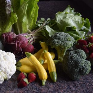 May seasonal vegetables and fruit: strawberries, summer squash, cauliflower, broccoli, beets, romaine lettuce