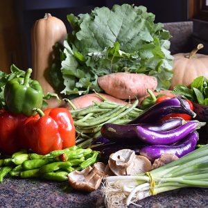 October vegetables in season: butternut squash, collards, eggplant, peppers, green onions, mushrooms, sweet potatoes