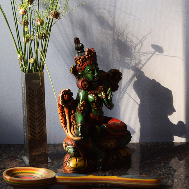 Green Tara with rainbow wooden spoon and flowers