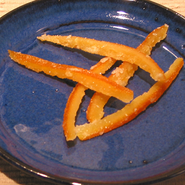 Candied orange peels on a blue plate