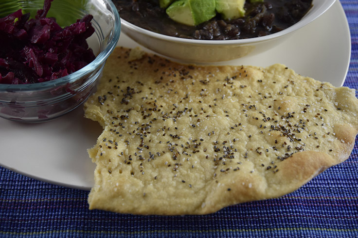 baked chia-seed cracker with curved edge