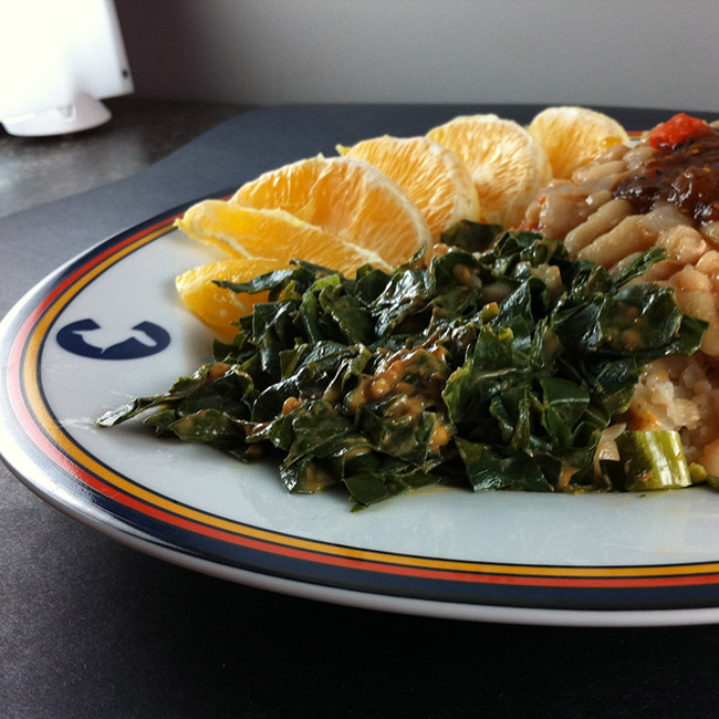 collards in peanut-lime sauce with orange segments and beans