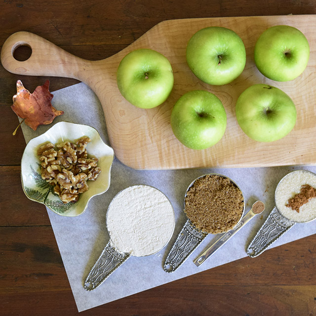Apple Crumble recipe ingredients: Granny Smith apples, walnuts, white whole wheat flour, sugar, cinnamon, and nutmeg