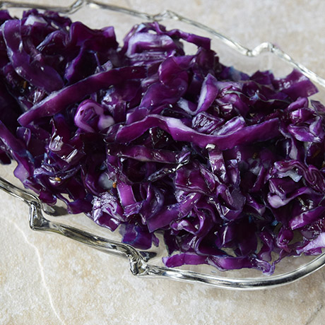 organic red cabbage sauerkraut in glass leaf relish dish