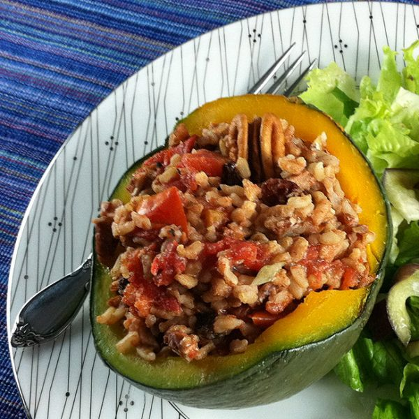 vegan stuffed kobacha squash with rice, pecans, and tomatoes