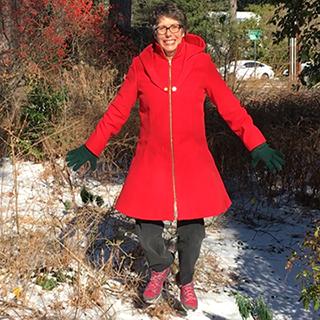 Linda Watson jumping in snow