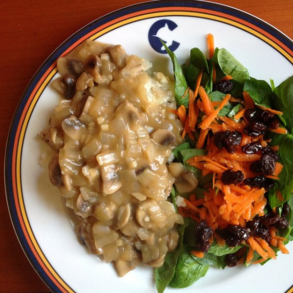 mashed potatoes with mushroom gravy and a tossed salad