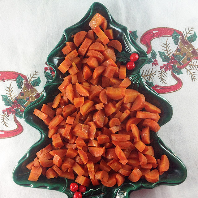 Precious Spice Carrots in a vintage Christmas tree dish on a Christmas tablecloth