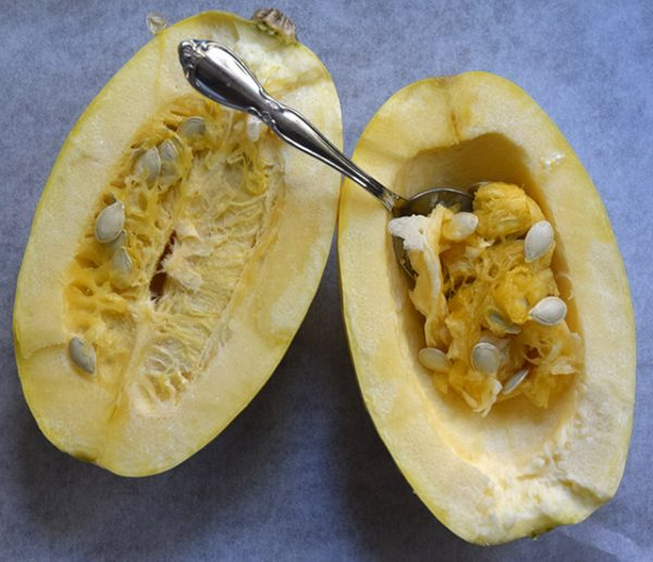 scraping seeds from a raw spaghetti squash