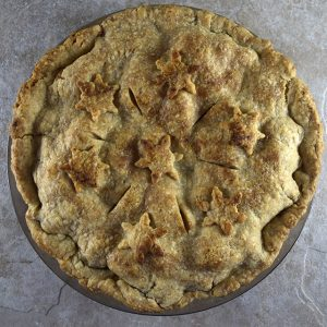 whole apple pie baked and decorated with stars