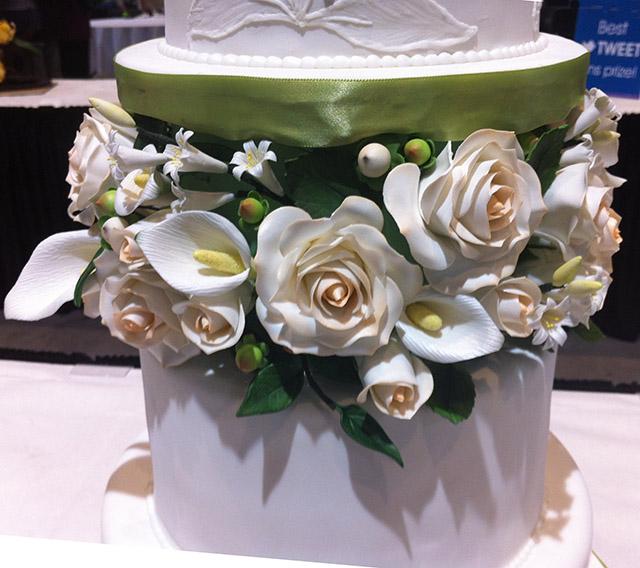 wedding cake with elaborate sugar flowers