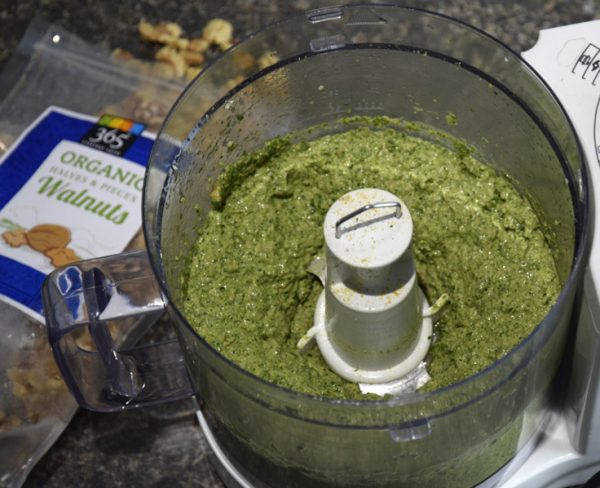 lemon spinach pesto in food processor with bag of organic walnuts