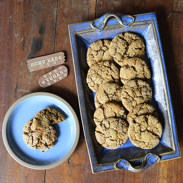 Bang Bang Carrot Spice Cookies on a plate and pottery tray with pottery signs saying vegan and homemade