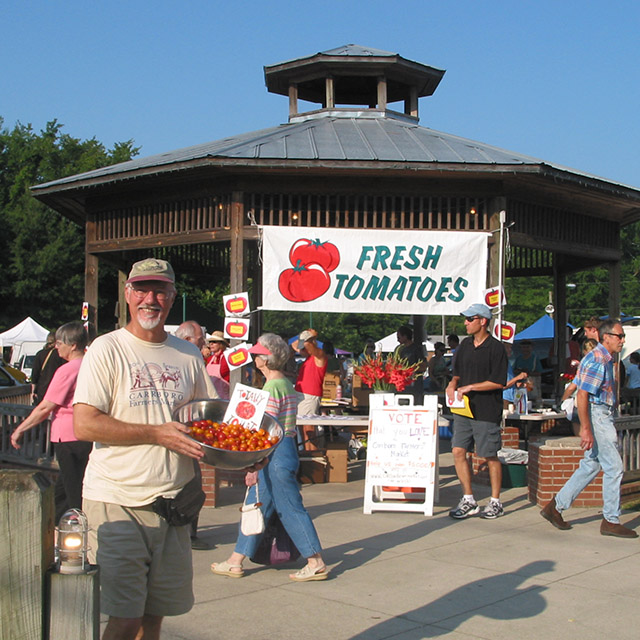 Man by Carrboro Farmers' Market pavilion on Tomato Day