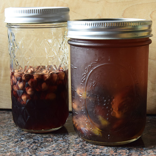 jars of cherry-pit and peach-pit syrup