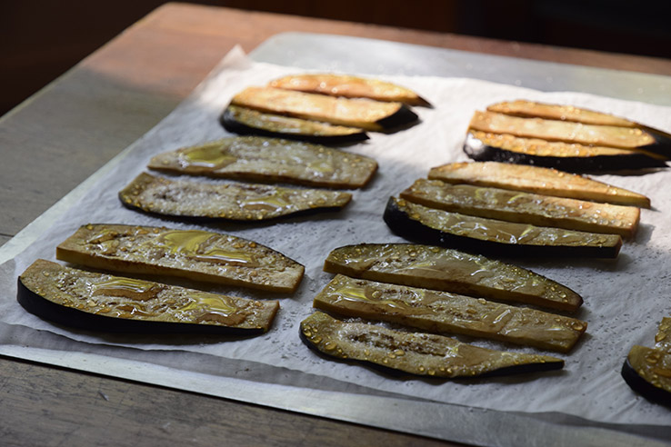 salted eggplant slices exuding bitter liquid