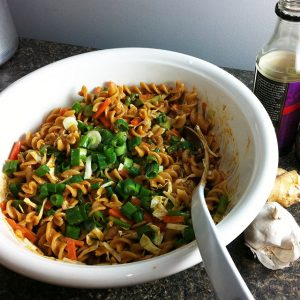 Spicy peanut noodles in big bowl
