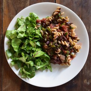 Summer pasta with olives and a green salad