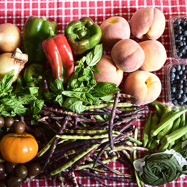 fresh tomatoes, peppers, basil, peaches, blueberries, black-eyed peas, okra, and onions from the farmers market