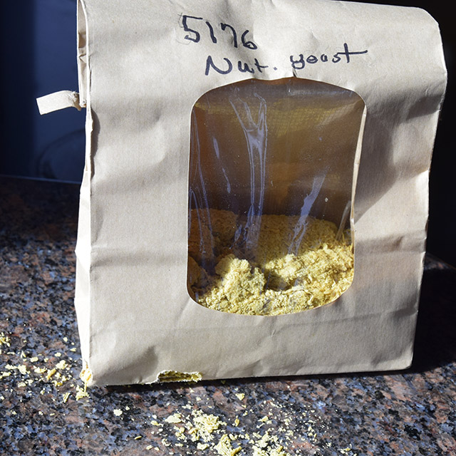 bulk bag chewed through by mouse with nutritional yeast spilling out