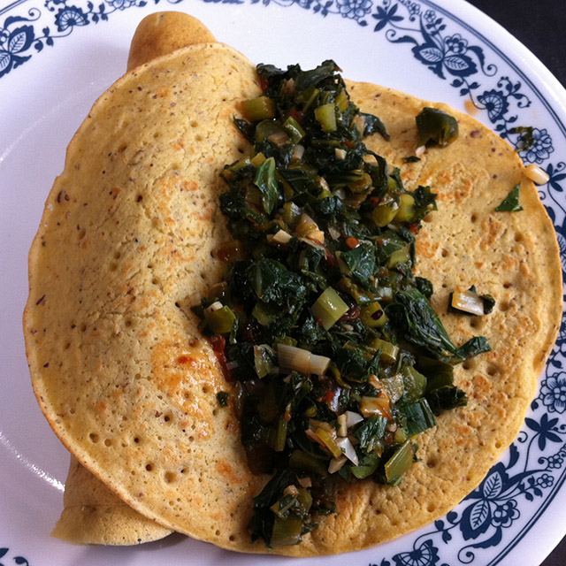chickpea-flour omelette or nomelette filled with kale, open