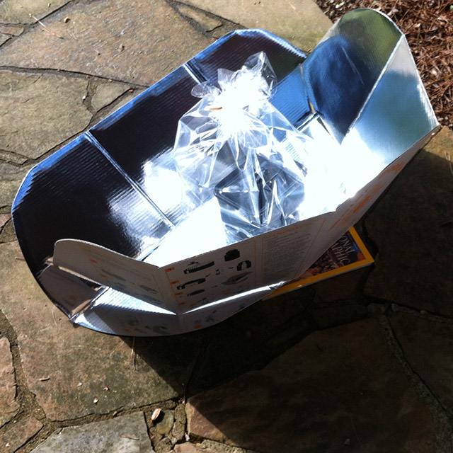 Cookit solar cooker outside in action