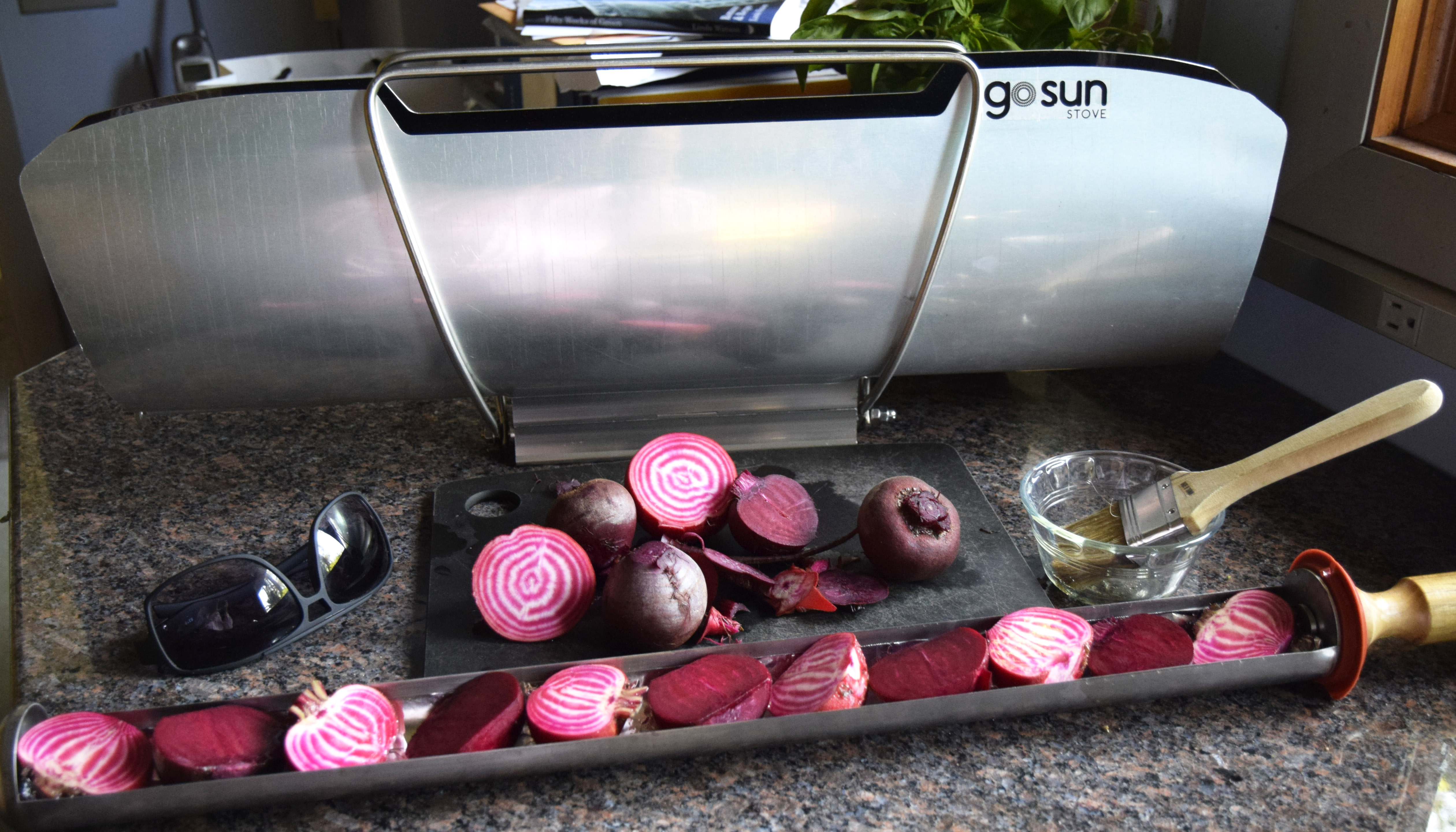 A GoSun solar stove with beets in the cooking tube