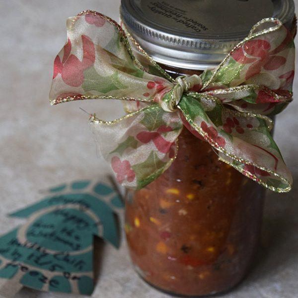 Holiday Chili in a mason jar with a ribbon and gift card
