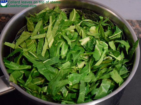 raw collard leaves in a steam basket