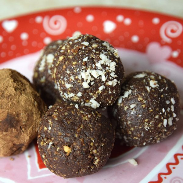 Chocolate Hazelnut Truffles plain, with coconut, and with cacao, on a Valentiine's Day heart plate