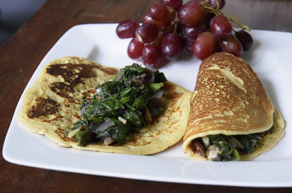 chickpea egg-free omelet with greens, mushrooms, onions, and red grapes