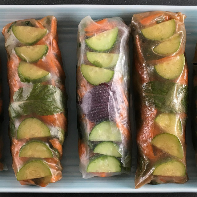 three summer rolls on a tray