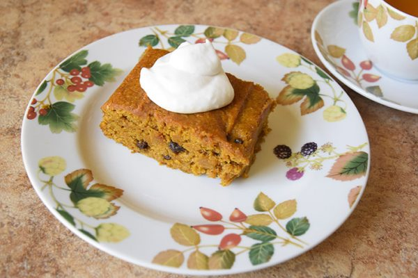 Kabocha Squash Comfort Cake with coconut whipped cream and a cup of tea