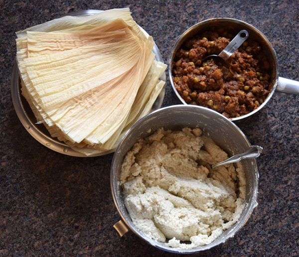 ingredients for vegan tamales: corn husks, filling, masa dough