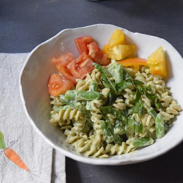 Avocado-lemon sauce on whole-wheat noodles with green beans and tomatoes