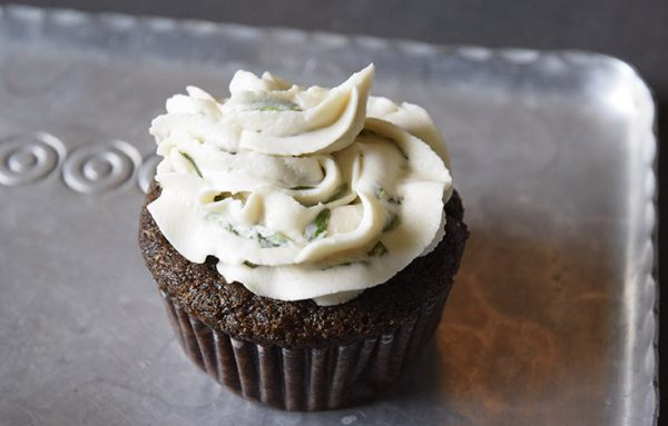 vegan chocolate cupcake with basil buttercream frosting