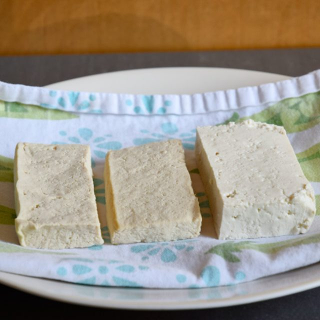 Two slabs of pressed tofu and one slab unpressed