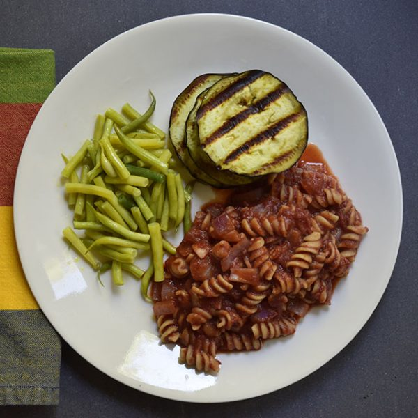 Dinner with grilled eggplant, pasta with tomato sauce, and wax beans